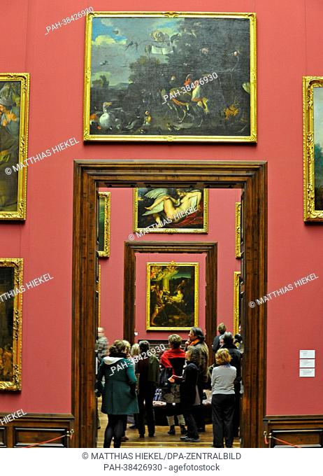 Visitors look at the newly hung Rubens paintings in the Gemaeldegalerie Alte Meister (Old Masters Gallery) in Dresden, Germany, 26March 2013