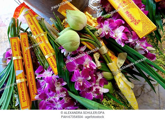 Offerings such as incense sticks, orchids and lotus flowers pictured on the ground at Wat Benchamabophit inBangkok,Thailand, 04 March 2016