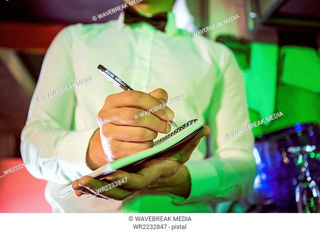 Waiter writing down an order