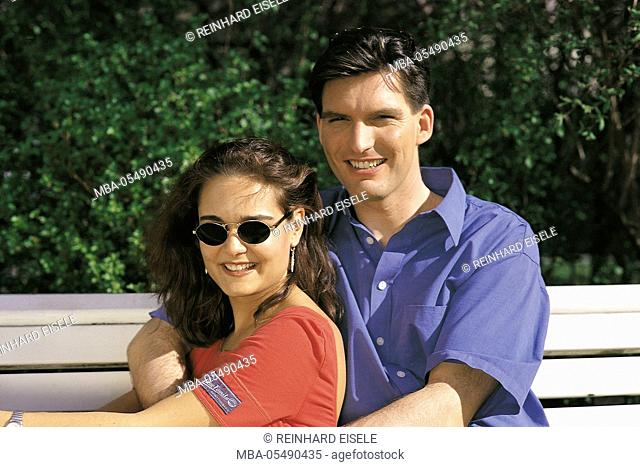 Young couple sits on a bank
