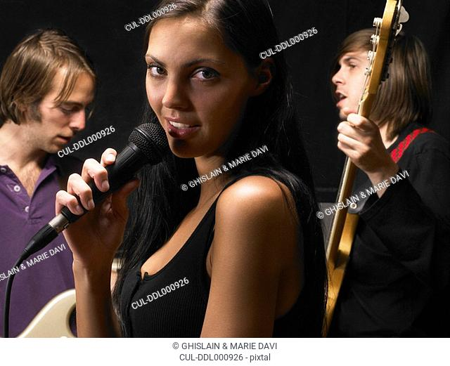 Woman singing in a band
