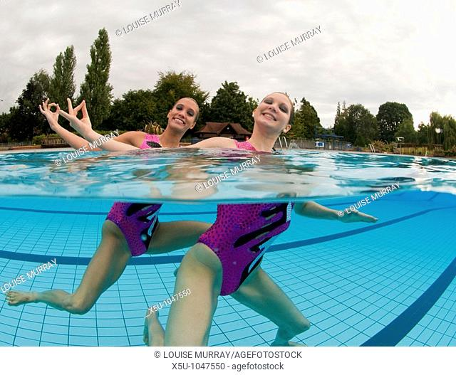 Greta Britain synchronised swimming team duet competitors, Jenna Randall 20,left and Olivia Allison 19  Shot at the heated pool of 1930's Guildford Lido