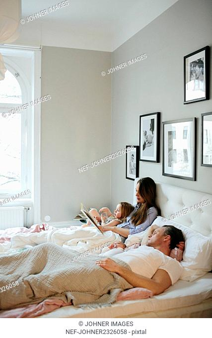 Family together in bed