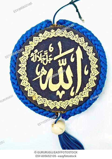 Close up of blue velvet Allah pendent isolated on white background