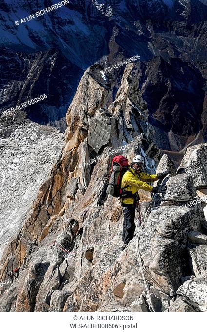 Nepal, Himalaya, Solo Khumbu, Ama Dablam South West Ridge, mountaineer climbing up rocks
