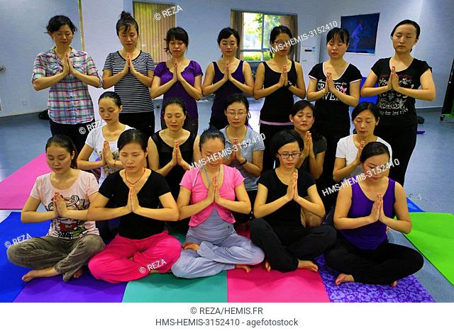 China, Shenzhen, Members of administrative teams and university professors participate in a yoga class at the South University of Science and Technology of...