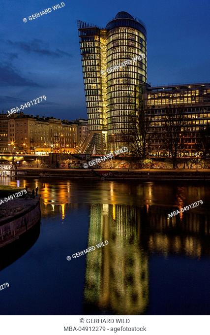 Austria, Vienna, building of the Uniqa insurance, reflexion in the Donaukanal (Danube canal)