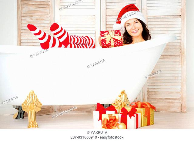 Santa girl having fun at home. Christmas holiday concept