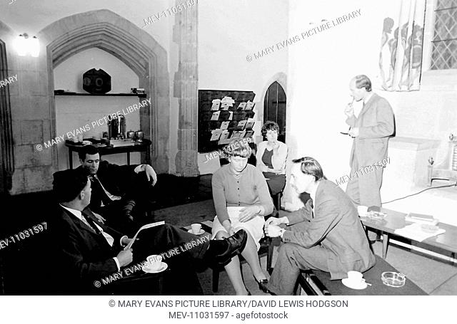 Six teachers relaxing in their common room at Atlantic College (United World College of the Atlantic), St Donat's Castle, Llantwit Major, Glamorgan, South Wales