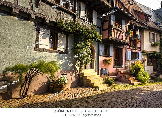 lane of Eguisheim, Alsace, France, colorful houses with stairs to the street