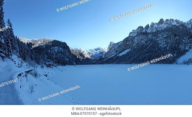 Frozen Lake Gosausee with view of Dachstein Massif and Gosau Ridge in winter at sunset, near Gosau, Salzkammergut region, Upper Austria, Austria