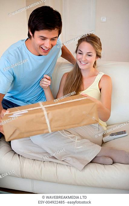 Portrait of a couple looking at a package