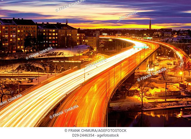 Sweden, Stockholm - Traffic on Essinge Highway at Dusk