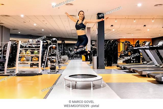 Young woman jumping in the gym