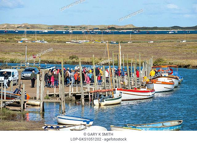 Morston Quay with tourists about to embark on to the boats to view the seals at Blakeney Point