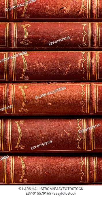Close-up of pile with old vintage books. Hardcover leather literature