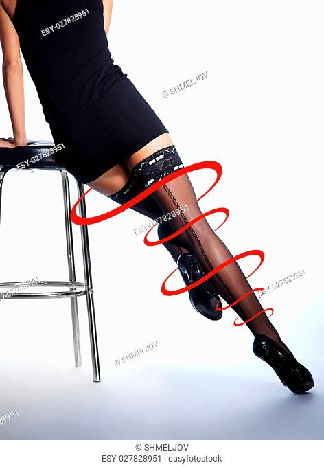Beautiful female legs in stockings isolated on white