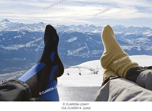 Resting feet on bench with mountain view