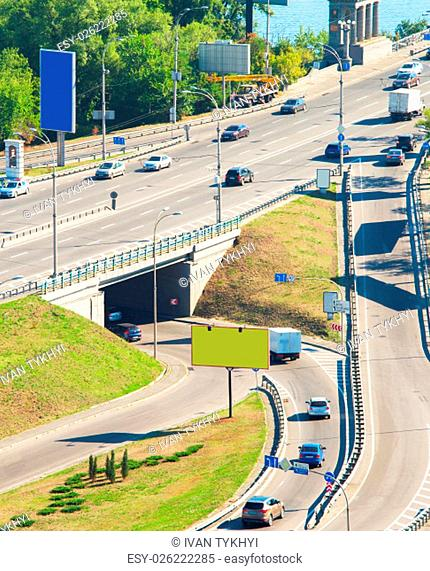Junction with billboard and cars. Paton bridge. Kiev, Ukraine