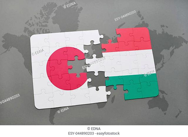 puzzle with the national flag of japan and hungary on a world map background. 3D illustration