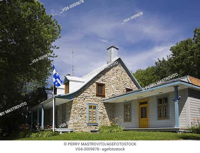 Old Canadiana Fieldstone (circa 1810) Cottage style Residential Home, Quebec, Canada. This image has a limited use property release. LUPR0134