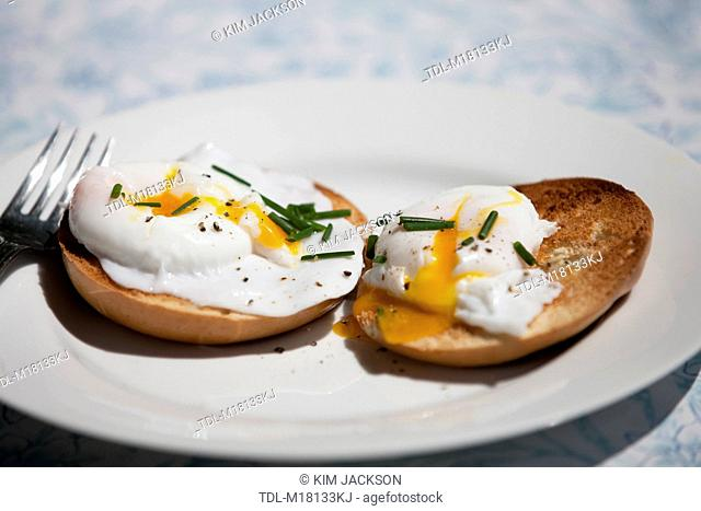Two poached eggs on a toasted bagel