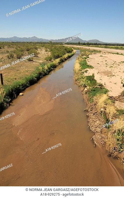 The Santa Cruz River flows with reclaimed water near Green Valley, Arizona, USA