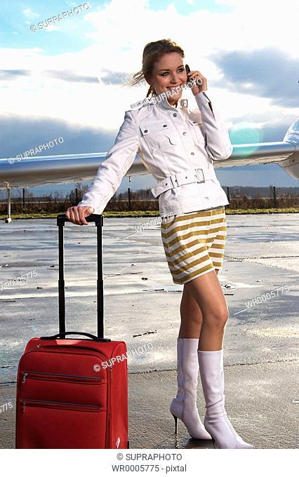 Woman airport suitcase Supraphoto