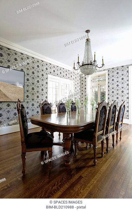 Table and chairs in ornate dining room