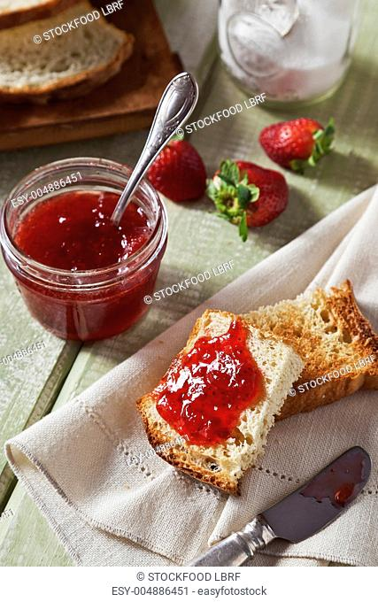 Homemade Strawberry Jam Spread Over Homemade Toasted Bread