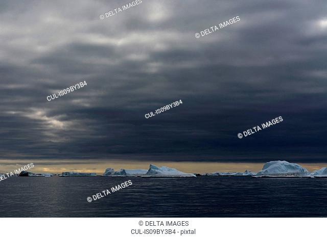 Icebergs under storm clouds, Vibebukta, Austfonna, Nordaustlandet, Svalbard, Norway