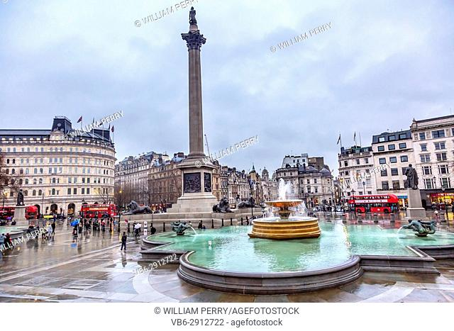 Trafalgar Square Fountain Traffic Circle Nelson Column Westminster London England. Square commemorates victory at Trafalgar in Napoleonic Wars by Nelson
