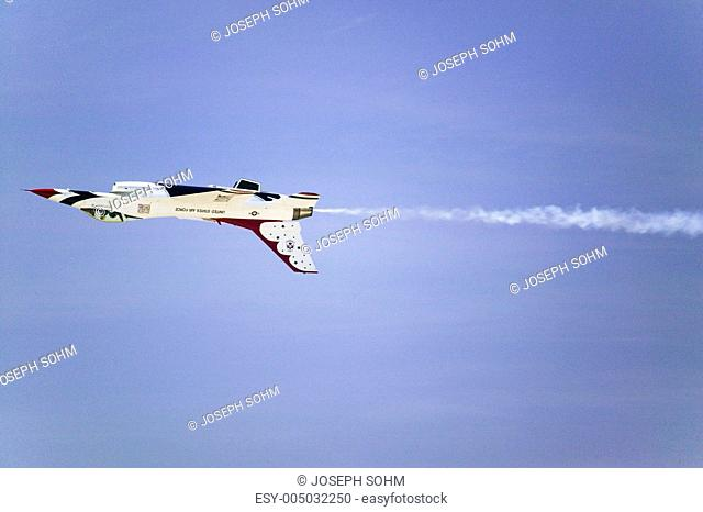 US Air Force F-16C Fighting Falcon, known as the Thunderbird, flying upside down over the 42nd Naval Base Ventura County NBVC Air Show at Point Mugu