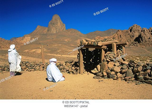 Tuareg men at prayer in a rudimentary outdoor mosque. Ahaggar Mountains, central Sahara, southern Algeria