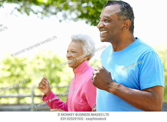 Senior African American Couple Jogging In Park