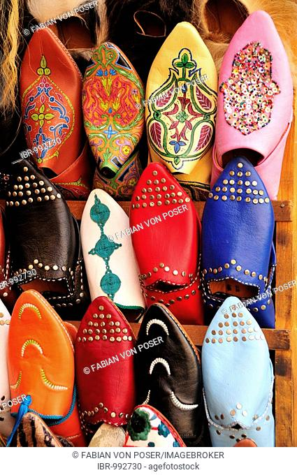 Typical Moroccan leather slippers in a shoe shop in the souk, market, in the Medina, historic town centre, Marrakech, Morocco, Africa