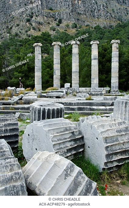 Visitors at Priene, ruins of an ancient Greek city of Ionia at the base of an escarpment of Mycale, 25 kilometres 16mi from ancient Miletus, Turkey