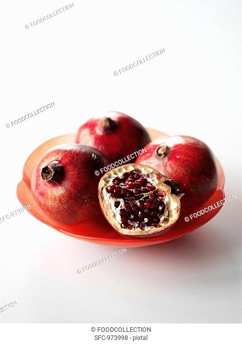 Pomegranates on a red plate