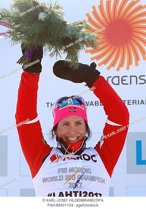 Marit Bjoergen of Norway cheers at the finish line during the women's 2 x 7.5km cross-country event at the 2017 Nordic World Ski Championships in Lahti, Finland