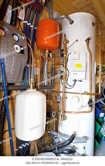 Low carbon central heating/water heating, United Kingdom. Low carbon central heating/water heating - Boiler/control room of Rika wood pellet burner in...