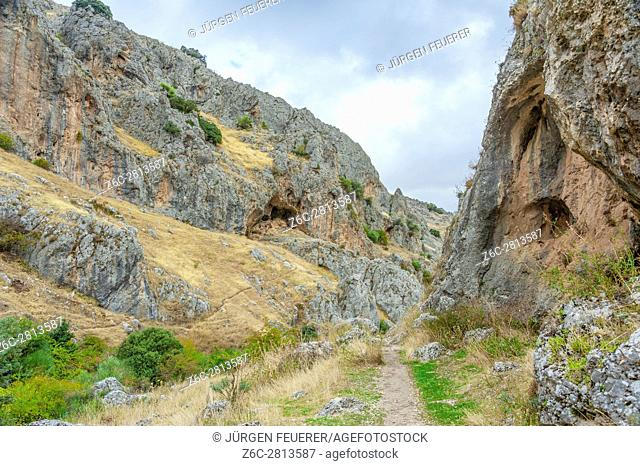Canyon of River Bailón, hiking path between rocks at the village Zuheros, White Towns of Andalusia, province Córdoba, Spain