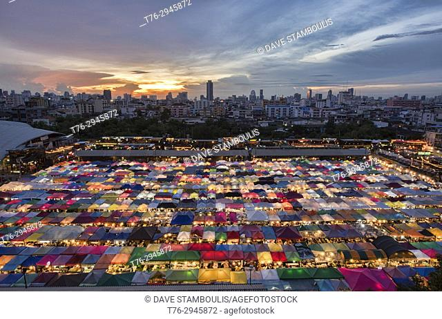 The colorful Ratchada Rot Fai Train Market at sunset, Bangkok, Thailand