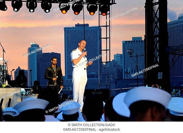 Chief of Naval Operations CNO Admiral Jonathan Greenert helps start the USO New York City Fleet Week block party by thanking the international audience of...