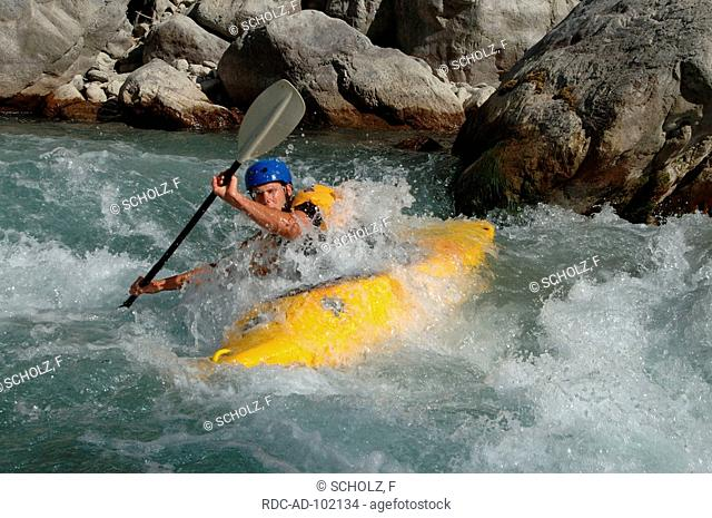 Whitewater kayaking on river near Chateau Queyras Hautes-Alpes France