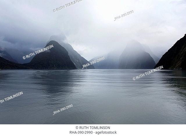 View down rainswept Milford Sound, mountains obscured by cloud, Milford Sound, Fiordland National Park, UNESCO World Heritage Site, Southland, South Island