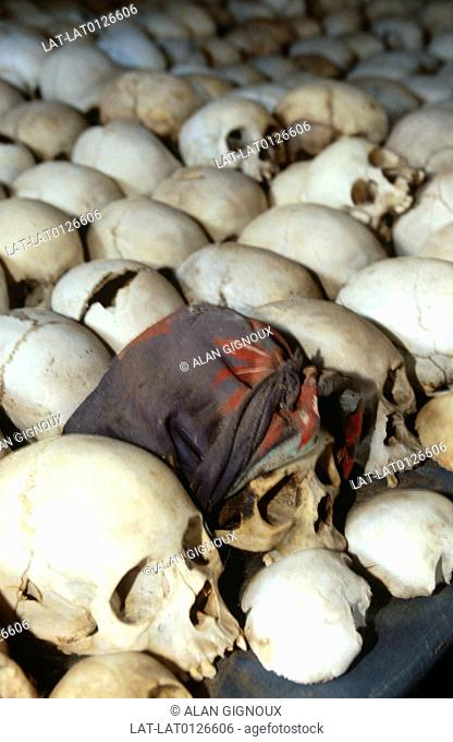 The Rwandan Genocide was the 1994 mass murder of an estimated 800,000 people. There are cemetery sites where skulls are ranged in rows