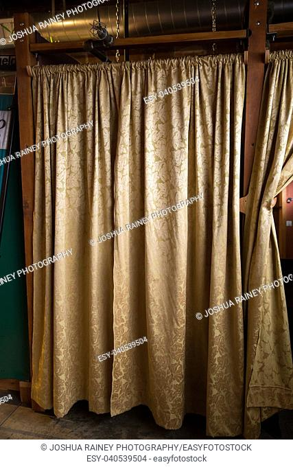 Vintage curtains create a changing room at a yoga studio