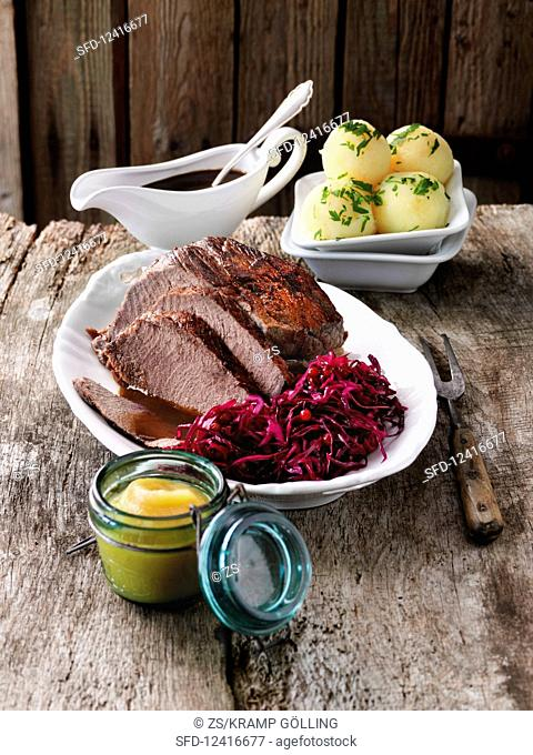 Sauerbraten with potato dumplings and red cabbage