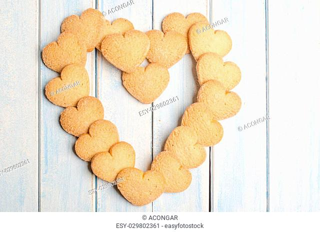 Big heart made with shortbread, aged blue wooden background