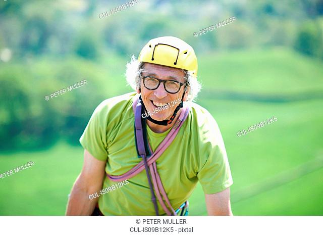 Portrait of senior man wearing climbing helmet